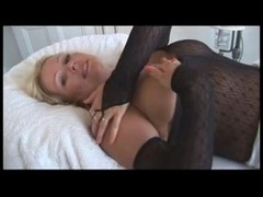 Mature slut masturbates in whole-body stockings