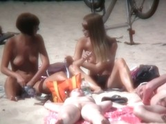 2 white babes with nice big side saggin breasts on a nude beach