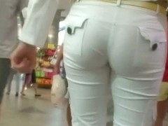 Sweet candid street booty in a shoe store