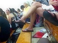 Lady dangling flip flops