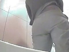 Great footage with peeing woman in a bathroom