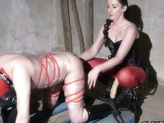 Dominatrix slut serves her slave with a BDSM fun