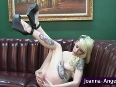 Tattooed slut shows pierced pussy