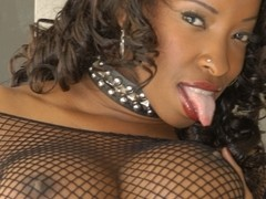 Sexy ebony whore knows how to use her big boobs