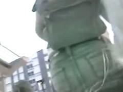 Beautiful ass upskirt under a pink skirt on the street in public