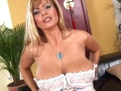 Older mommy Adele from OlderWomanFun shows her large bazookas