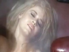 Blonde reaches orgasm in a weird retro porn movie