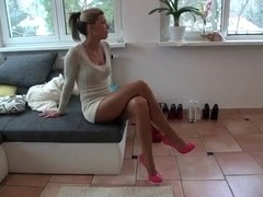 Handsome harlot shows her sexy legs in stockings