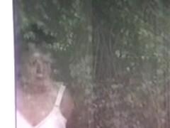 mature neighbor putting on bra