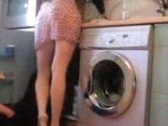 Wonderful upskirt of the housewife cleaning her kitchen