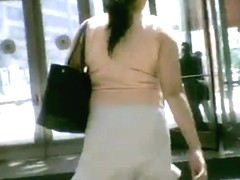 Bare ass upskirt on the escalator