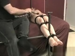 tied and having her feet tickled