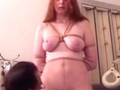 Redhead with large naturals fastened and has her slit teased