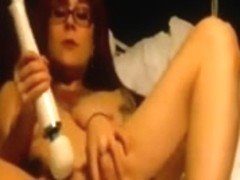 Busty emo redhead pleasing her pussy with her toy