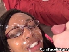 Glasses wearing darksome lady takes facual cumshots