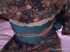 Kimono clad Asian teen Ai Uehara gives a hot blowjob