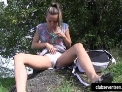 Perky titted teen Nessy masturbating cunny outdoors