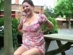 This British mature slut loves exposing her private parts outdoors