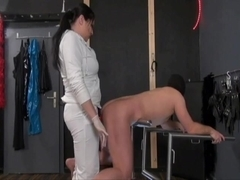 Dominatrix strap-on fucks a slave real good
