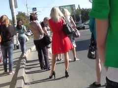 Blond in hot red suit darksome up petticoat