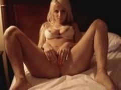 Cute blondie masturbates