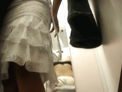 Voyeur dressing room video with female trying on new dress