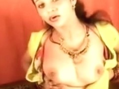 Busty Indian bhabi plays with her tits and slit