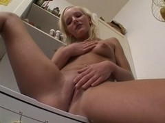 sexy german blond plays with herself alone