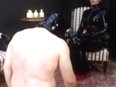 Two scenes: Dominatrix spanks, slaps, spits on sub