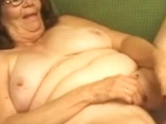 Granny in Glasses Undresses and Plays