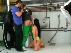 Beautiful brunette Regina Moon is getting filmed on camera with two dudes; she is sucking both dic.