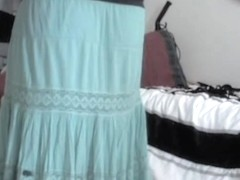 Amateur woman lifts her long skirt up uncovering white ass