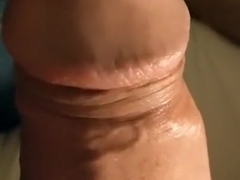 guy jerking off a huge dick and pouring himself with sperm