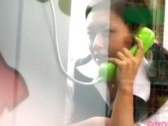 Pretty Asian in the phone booth got cumshot sharked