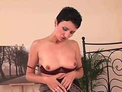 Sexy soccer mom with fuckable body plays with dildo