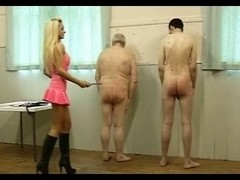 Sexy Domme in Pink Latex Works Over Her 2 Slaves