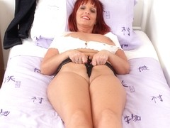 British milf Beau Diamonds dildos her fuckable fanny