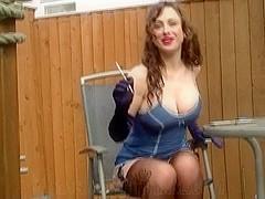 Sexy Brunette smoking outside & teasing