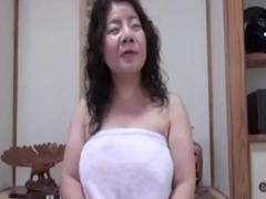 Japanese milf enjoys herself
