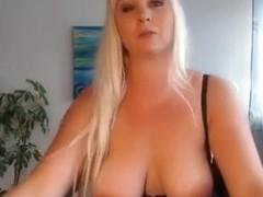 Bosomy blonde in black stockings fucks herself with her dildo