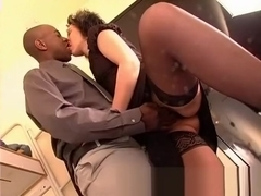 French Brunette in stockings takes a black cock