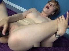 Ava Little wears her silly socks while she fucks her twat with a huge dong