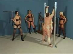 Three cruel mistresses whipping a fat slave
