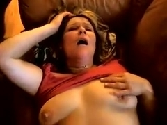 Heather masturbates on the sofa