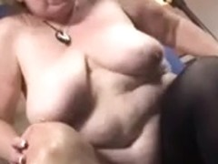 big beautiful woman granny in act on sofa