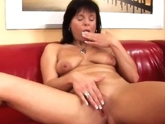 Older mommy plays with her swollen cunt