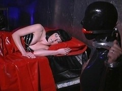 Latex bitch in kinky latex catsuit plays rough games