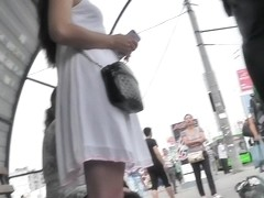 Filming upskirt bus stop action with amateur chick