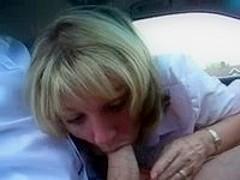Mature blonde sucks cock in car