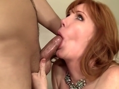 Stunning redhead milf with big boobs gets her aching pussy creampied